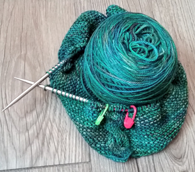 knitting garter stitch in the round with cables