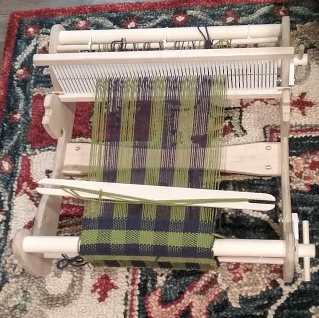 blue and green plaid fabric on a rigid heddle loom