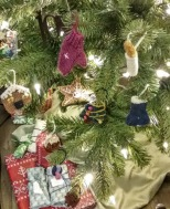 knitted ornaments on a christmas tree