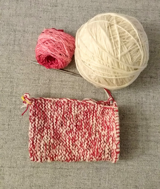 knitting with white and red wool